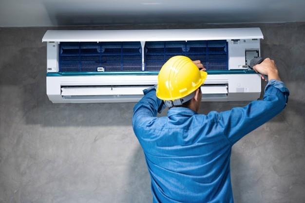 Air conditioning expert repairing an aircon